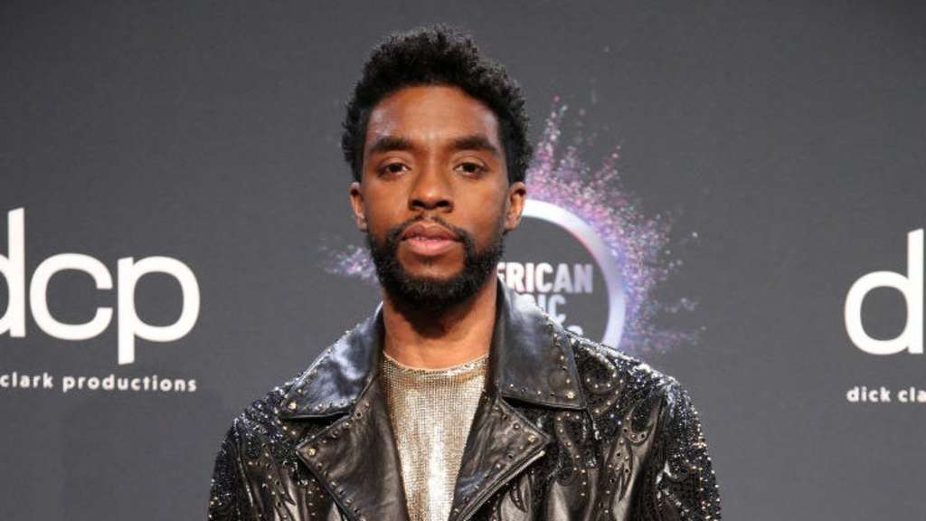 Chadwick Boseman wears an embroidered leather jacket to a Hollywood event