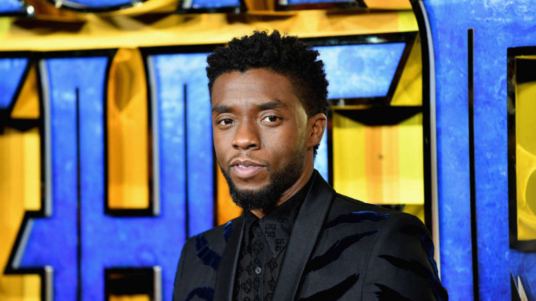 """Chadwick Boseman poses at the """"Black Panther"""" movie premiere"""