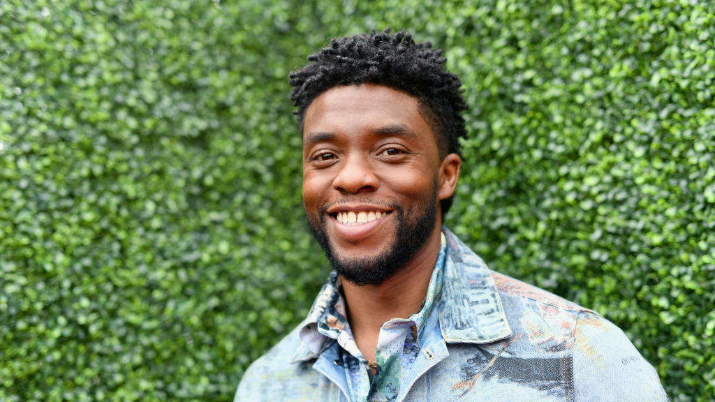 Chadwick Boseman poses at a Hollywood event