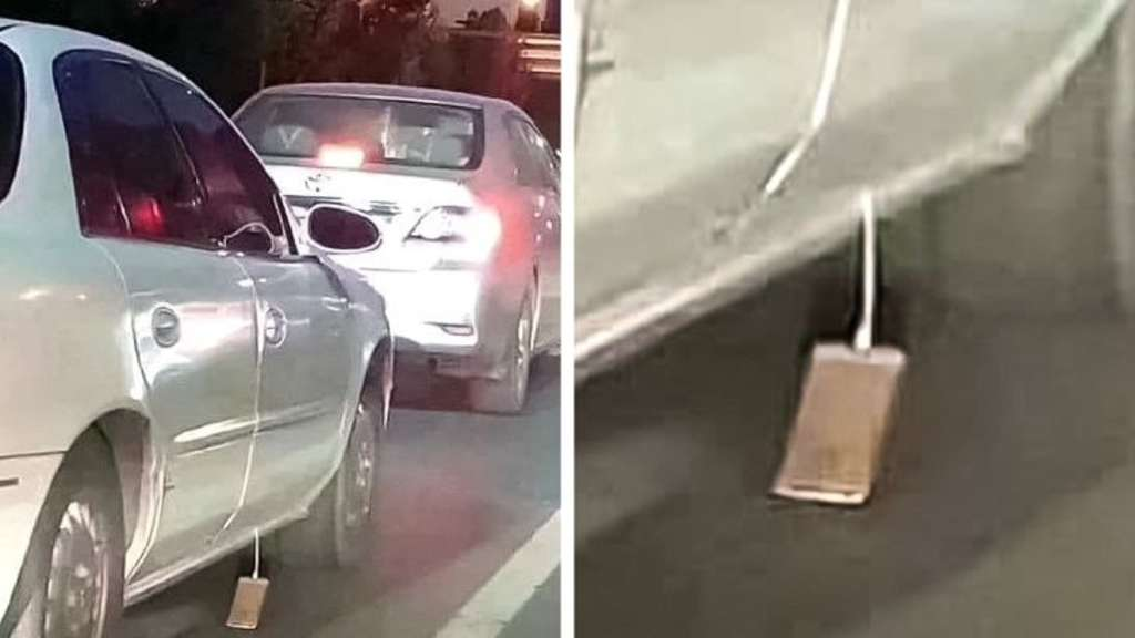 picture of an iphone dragging out of a car on the ground