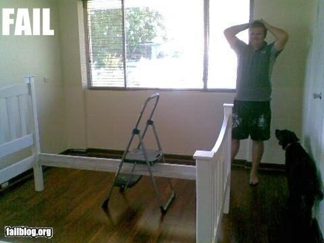 bed frame with a step ladder stuck through it