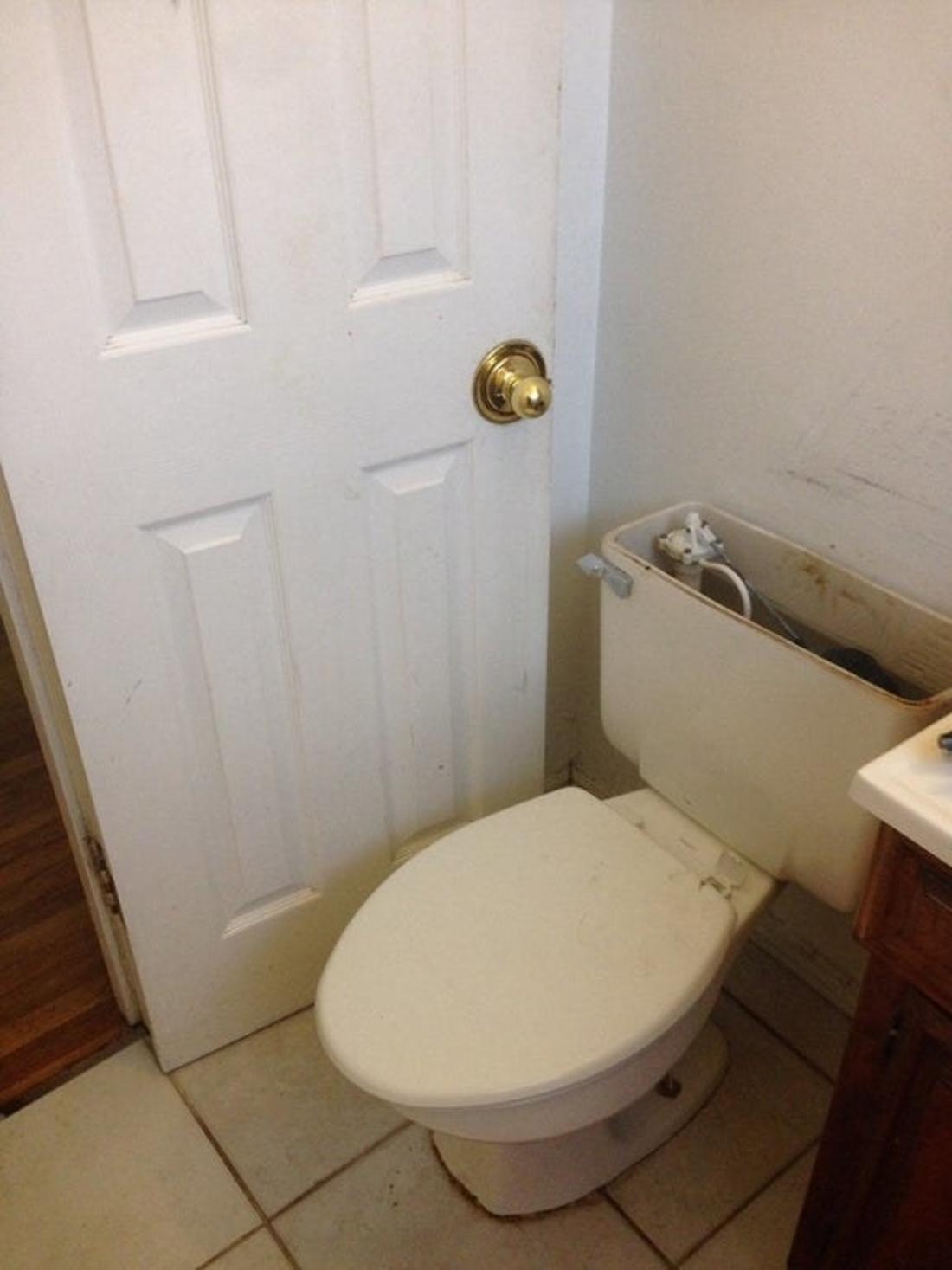 toilet blocking a door from closing