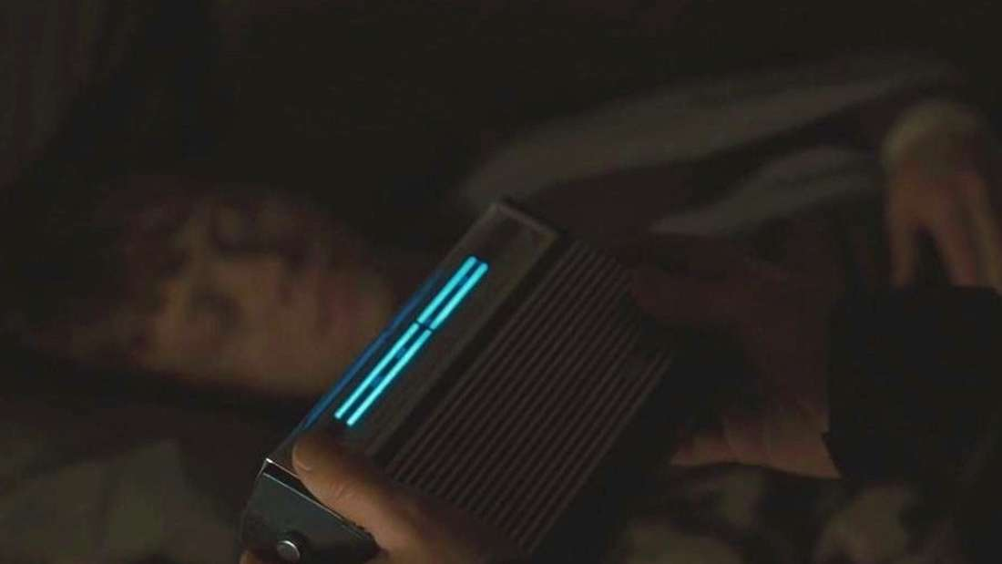 Harry holding a radio near Ron while Ron sleeps