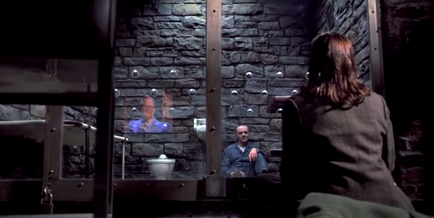 Anthony Hopkins in a prison cell with Jodie Foster outside in Silence of the Lambs