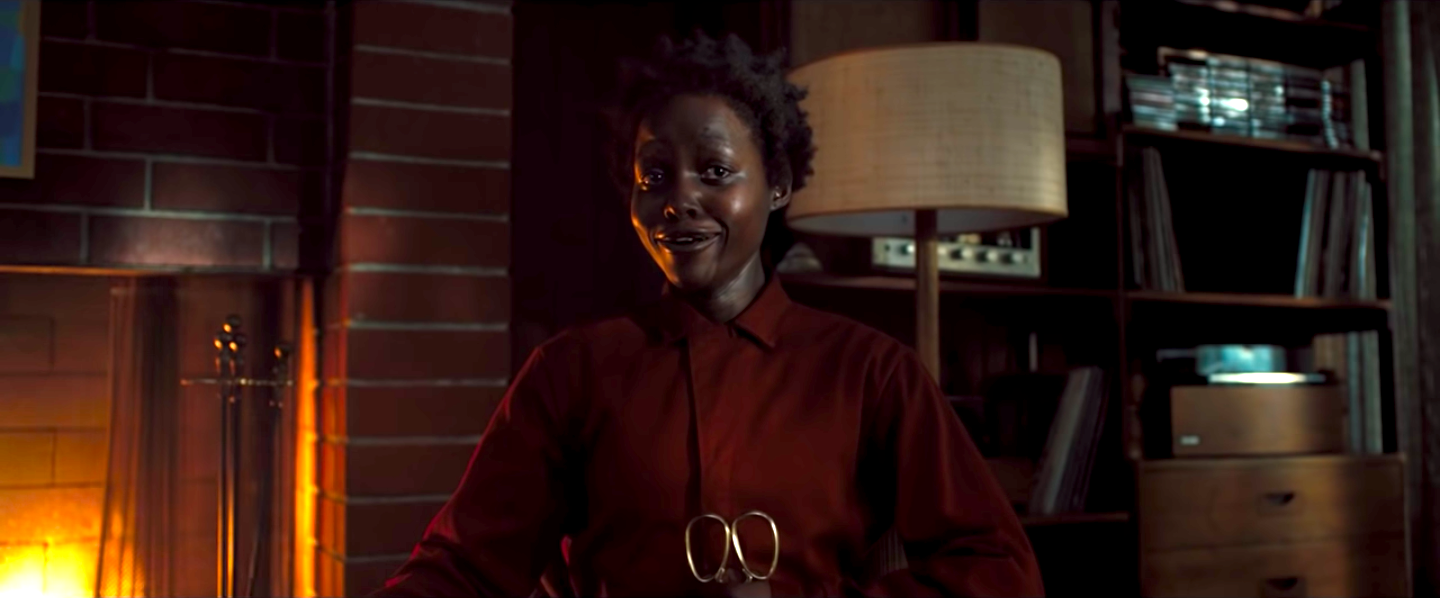 Lupita Nyong'o smiling creepily in Us
