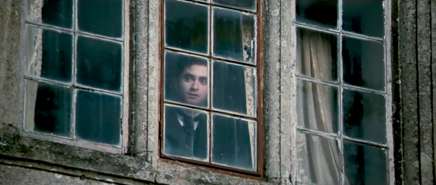 Daniel Radcliffe looking out a window in The Woman in Black