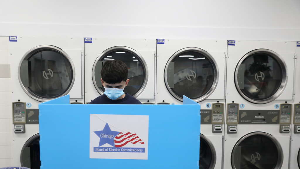 Man voting at a laundromat.