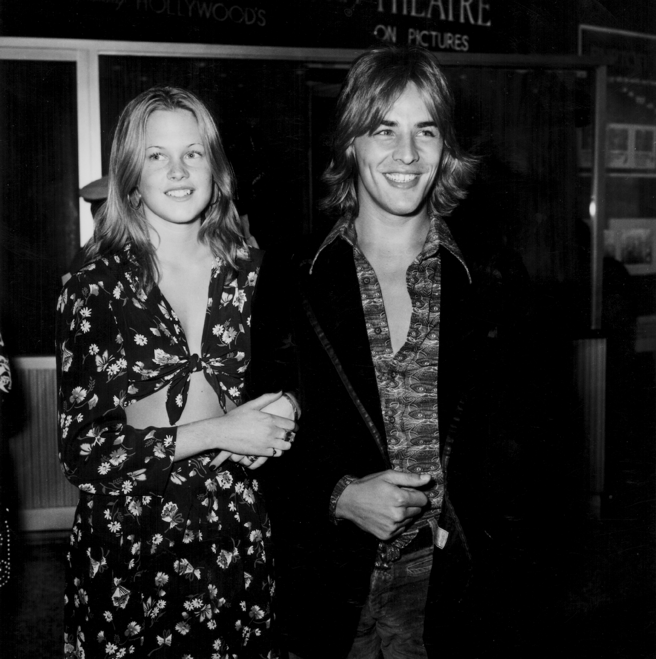 Young Melanie linking arms with Don — both of them smiling.