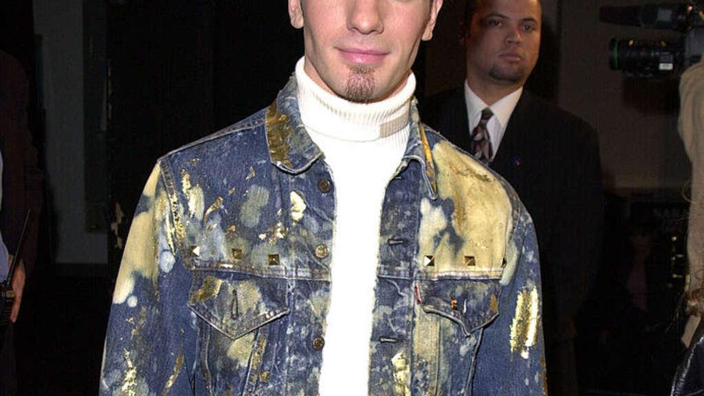 JC with a splotchy jean jacket