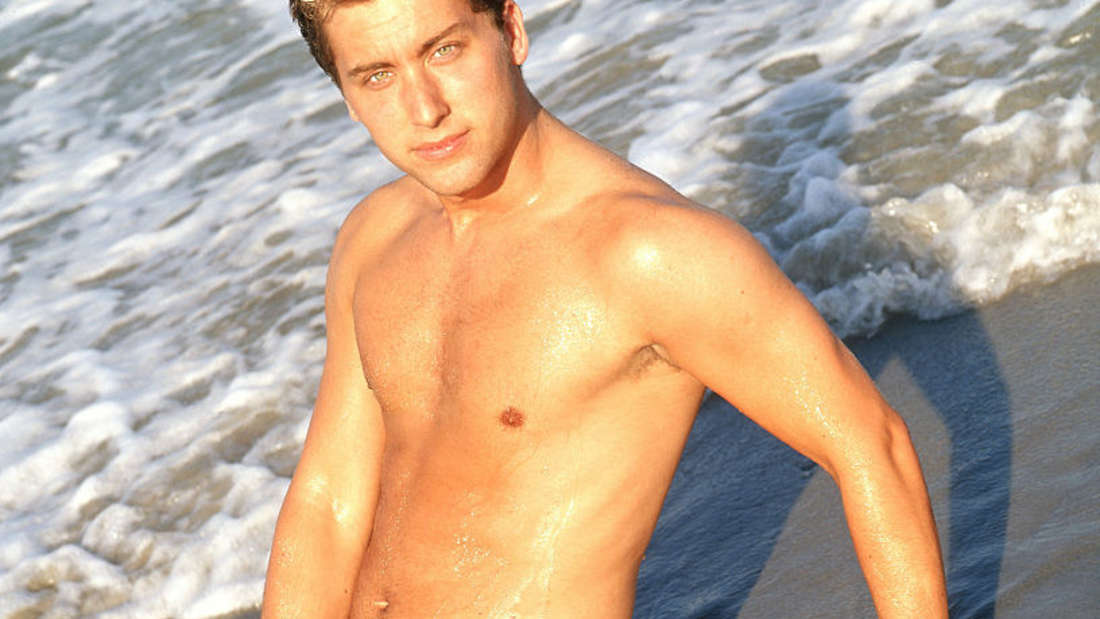 Lance Bass on a beach with jeans