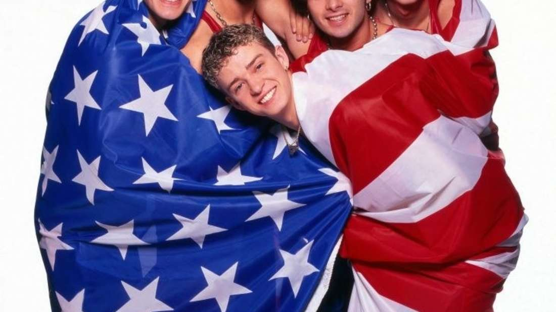 NSYNC wrapped in an American flag