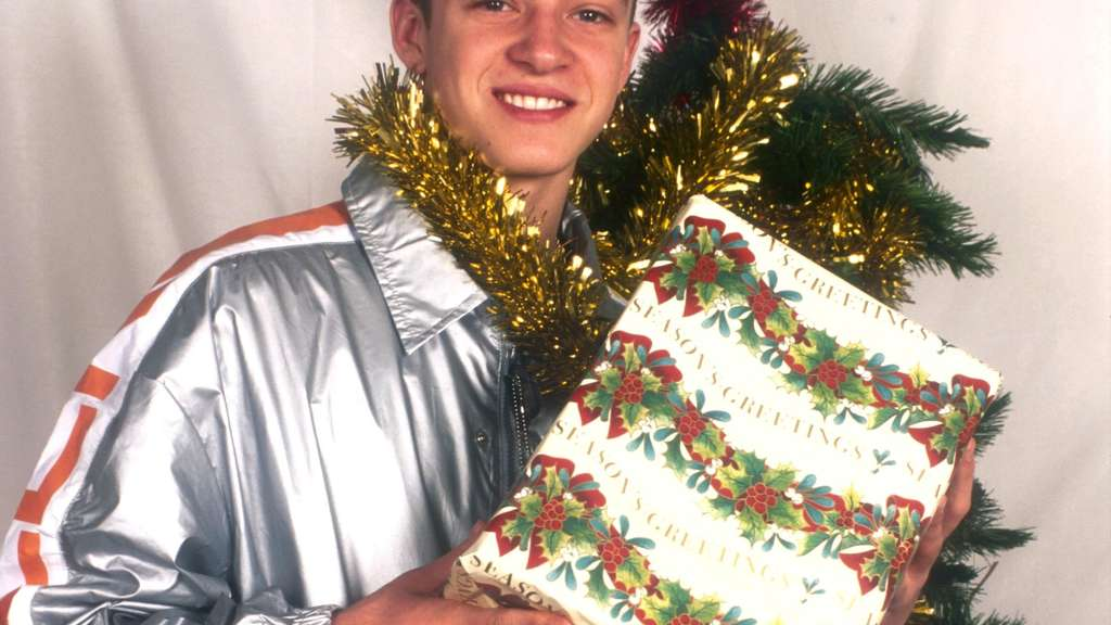 Justin Timberlake and a present wrapped in tree garland