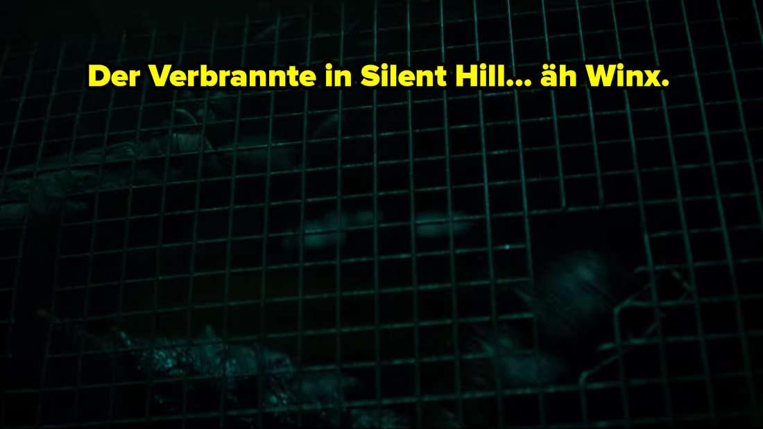 """Ein Verbrannter stürzt sich gegen ein Gitter. Darüber steht: """"Der Verbrannte in Silent Hill... äh Winx"""""""