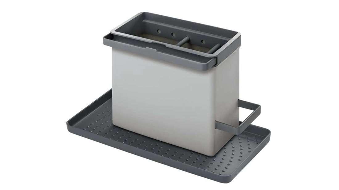 Ein Spülbecken Organizer in grau, mit Platz für Schwämme, Bürsten, etc.