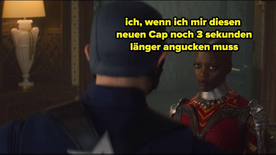 """Der neue Captain America John Walker und Ayo stehen sich in """"The Falcon and The Winter Soldier"""" gegenüber, während Ayo wütend aussieht. Auf dem Bild steht """"ich, wenn ich mir diesen neuen Cap noch 3 sekunden länger angucken muss."""""""