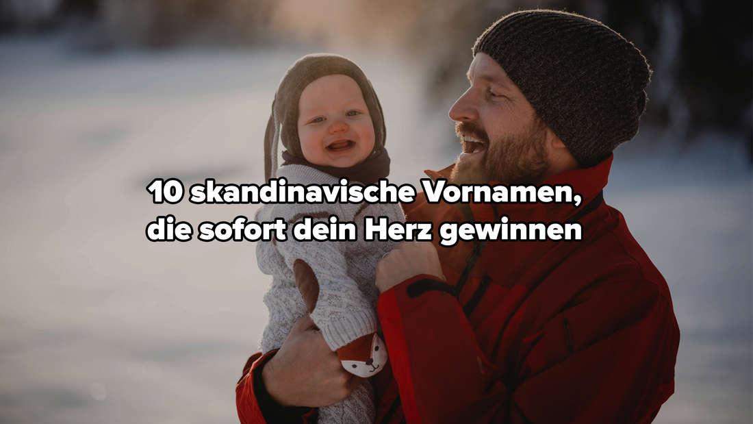 """Ein Vater, der sein Baby in den Armen hält, das lächelt. Beide sind sehr dick angezogen und stehen in einer verschneiten Landschaft. Auf dem Bild steht """"10 skandinavische Vornamen, die sofort dein Herz gewinnen""""."""