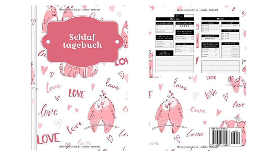 Ein weißes Tagebuch mit rosa Vögeln und Herzen darauf.