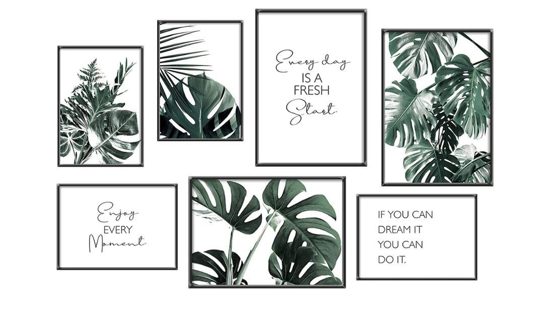 """7 Bilder in schwarzen Rahmen mit dunkelgrünen, exotischen Blättern und Motivationssprüchen darauf: """"Enjoy Every Moment"""", """"If you can dream it you can do it"""" und """"Every day is a fresh start"""""""