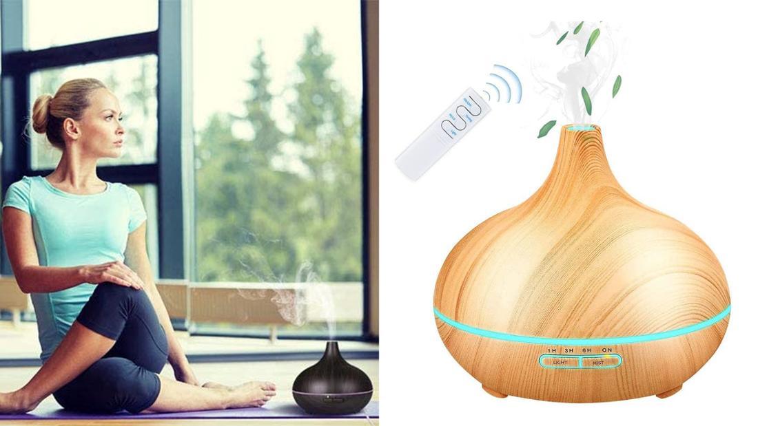 Ein Aroma Diffusor in Holzoptik mit LED-Licht zwischen Boden und Deckel. Und LED-beleuchteten Bedienfeld.