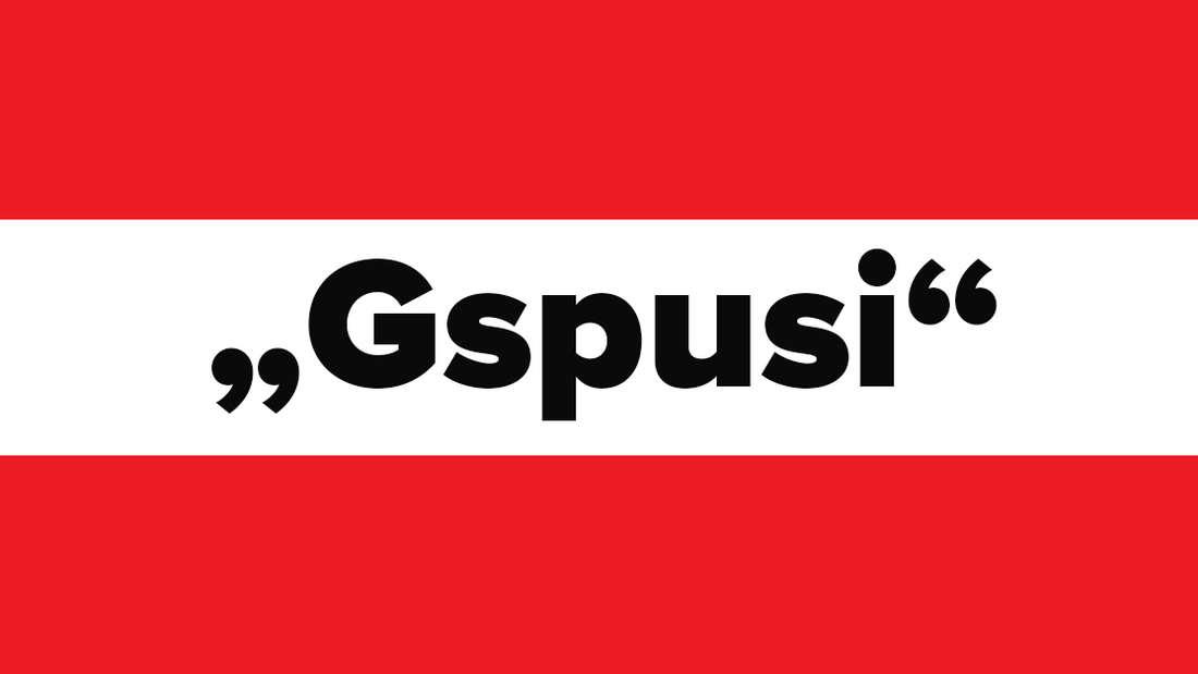 """Österreichische Flagge mit dem Wort """"Gspusi"""" in der Mitte."""