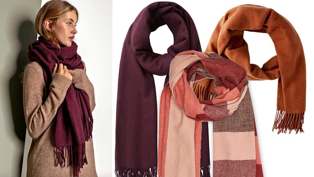 Verschiedene lange Schals, in Braun- und Rottönen mit und ohne Muster.