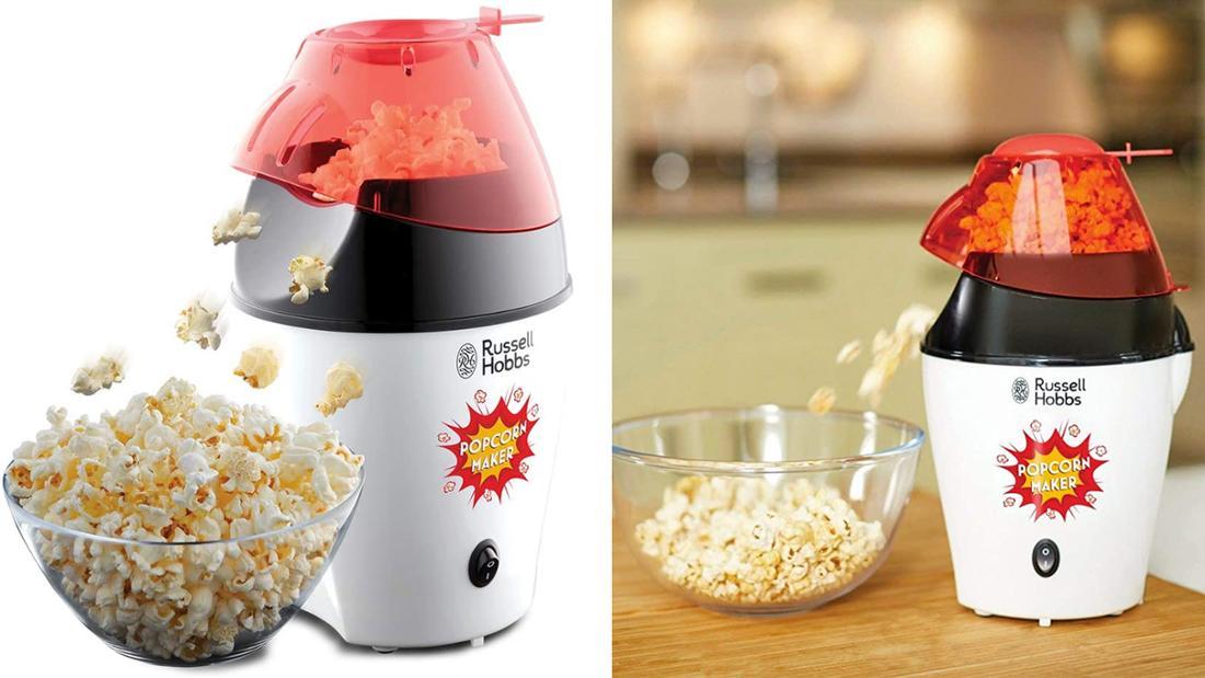Kleine Popcornmaschine in weiß mit roten Deckel und einfachem Ein-und-Ausschalter. Popcorn wird seitlich aus dem Deckel ausgeworfen.